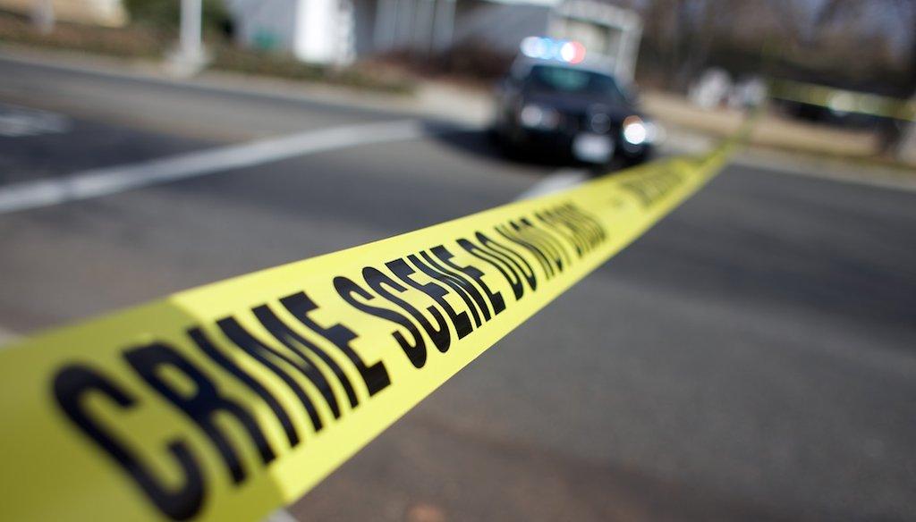Crime scene tape / Capital Public Radio file photo