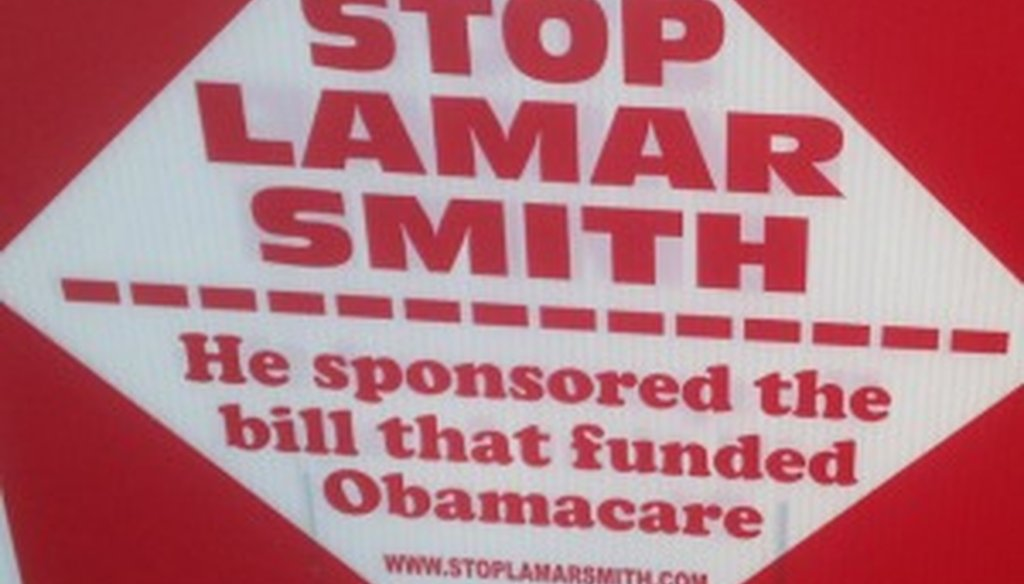 We spotted this sign making an Obamacare claim about Lamar Smith outside an Austin polling place Feb. 23, 2014.