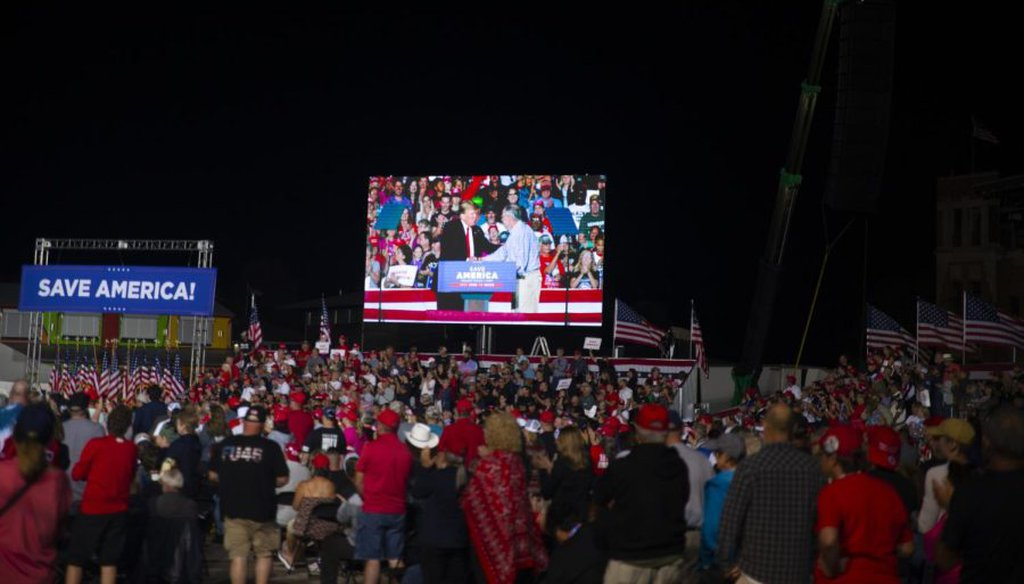 Former President Donald Trump greets Sen. Chuck Grassley, R-Iowa, after endorsing the senator on Saturday night. (Cecilia Shearon/The Daily Iowan)