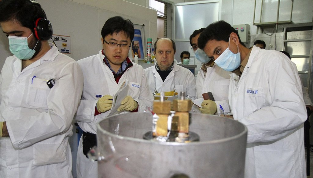International Atomic Energy Agency inspectors and Iranian technicians monitor the Natanz facility in Iran on Jan. 20, 2014. (AP Photo)
