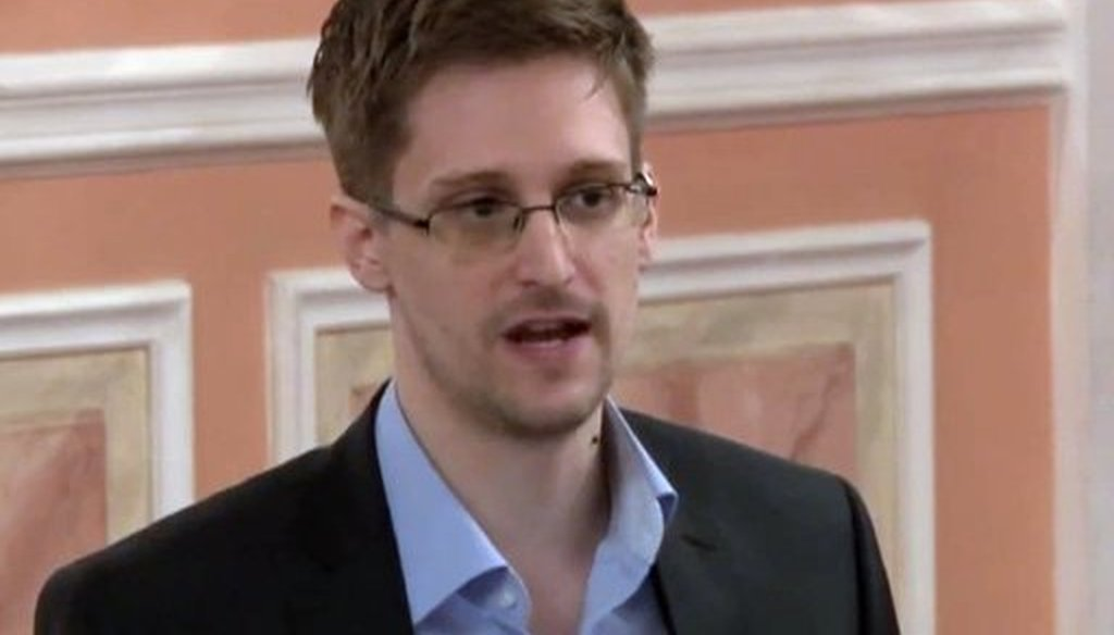 A fake news story claimed that NSA leaker Edward Snowden had proof that Osama bin Laden was still alive, living with family in the Bahamas. (AP photo)