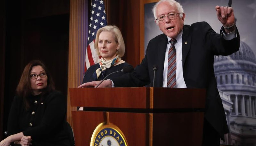 Sen. Bernie Sanders, I-Vt., right, with Sen. Tammy Duckworth, D-Ill., left, and Kirsten Gillibrand, D-N.Y., speaks to reporters during a news conference about the Family Act, Tuesday, March 14, 2017, on Capitol Hill in Washington. (AP Photo/Manuel Balce)
