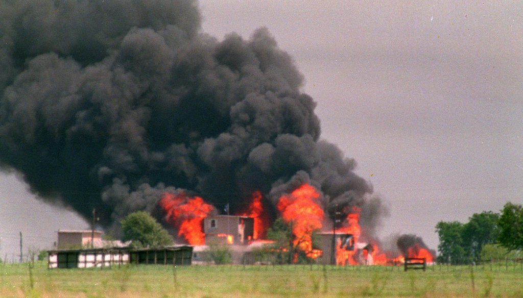 This April 19, 1993, file photo shows flames engulfing the Branch Davidian compound in Waco, Texas, after the U.S. government raided the compound. (AP)