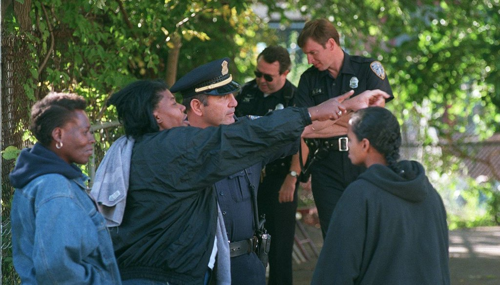 Sgt. Ralph Abernathy of Providence Police speaks with witnesses and neighbors at the scene of a shooting on Public Street in Providence in 1998. (The Providence Journal / Mary Murphy)