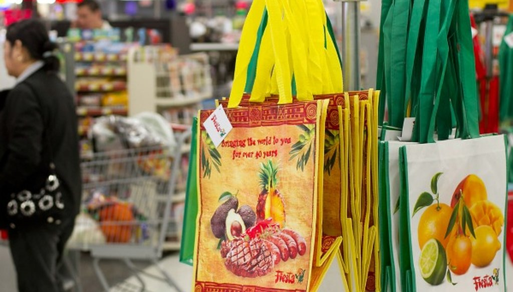 These Texas bags, all reusable, were for sale in Austin in 2013 (Photo, Laura Skelding, Austin American-Statesman).