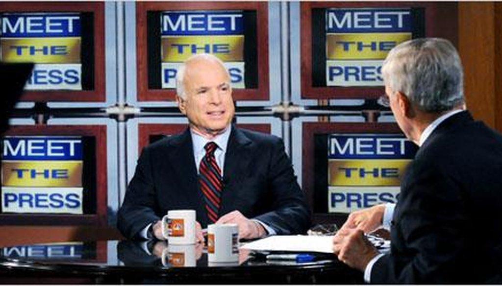 "Sen. John McCain speaking with Tom Brokaw, host of ""Meet the Press,"" in Waterloo, Iowa, in 2008. (Getty Images)"