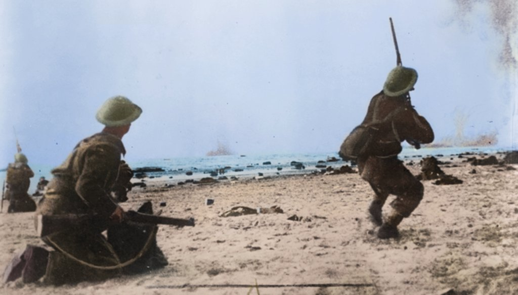 British troops fire their rifles at German planes on a bombing run over the beach at Dunkirk. (Cassowary Colorizations, via Flickr Creative Commons)