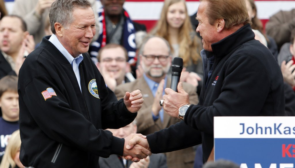 Arnold Schwarzenegger endorses Ohio Gov. John Kasich for president at a rally in Columbus. Jay LaPrete / AP