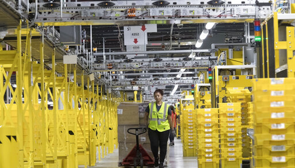 An Amazon employee moves merchandise through a fulfillment center in New York on Dec. 5, 2018. (AP/Altaffer)