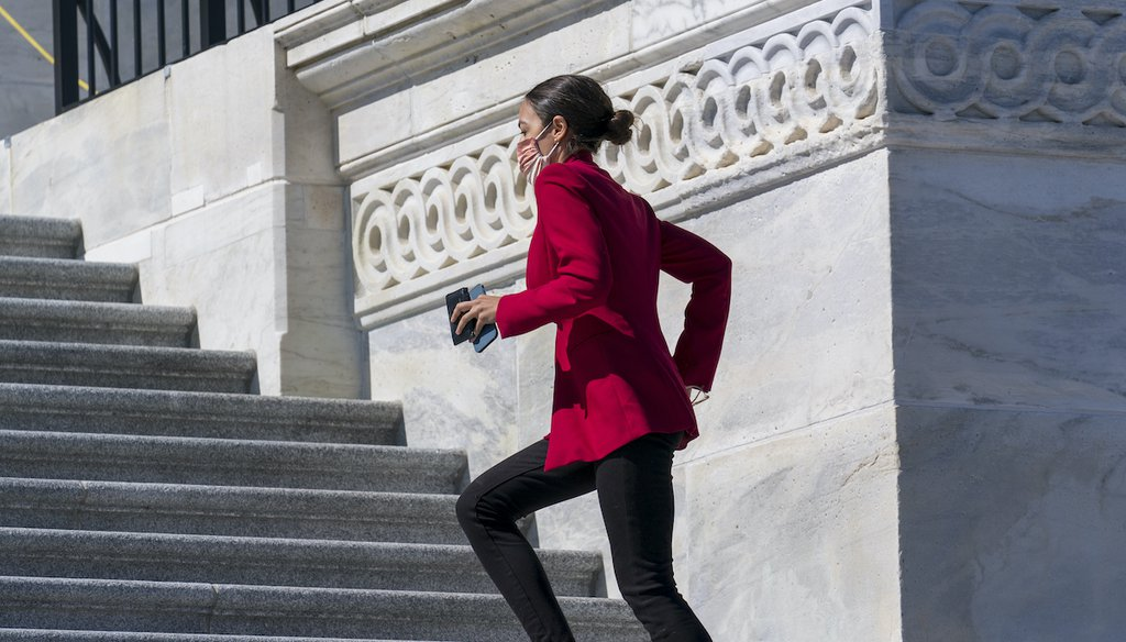 Rep. Alexandria Ocasio-Cortez, D-N.Y., sprints up the steps of the House of Representatives as she rushes to a vote, at the Capitol in Washington, Wednesday, March 3, 2021. (AP)