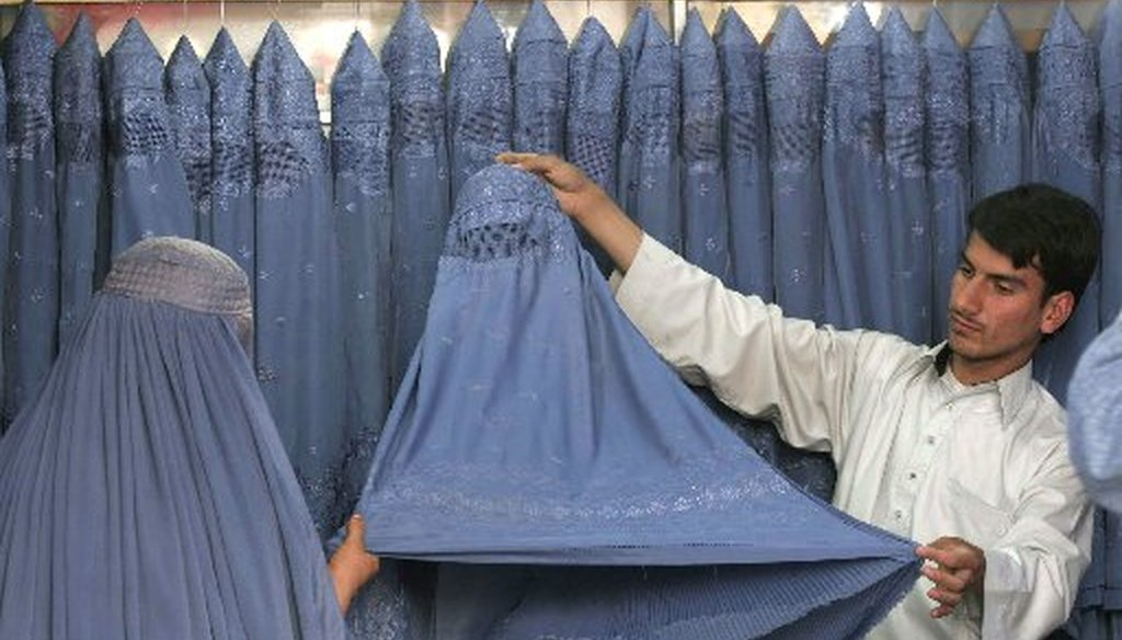A Muslim woman looks at burqas for sale in Kabul, Afghanistan. (AP file photo/2008)