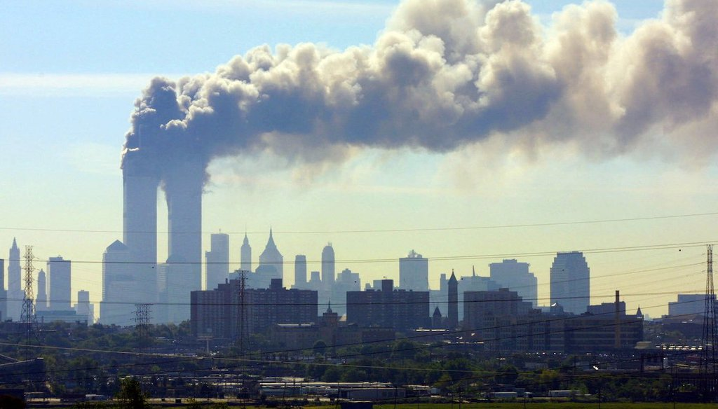 As seen from the New Jersey Turnpike near Kearny, N.J., smoke billows from the twin towers of the World Trade Center in New York after airplanes crashed into both towers on Sept.11, 2001. (AP/Boyars)