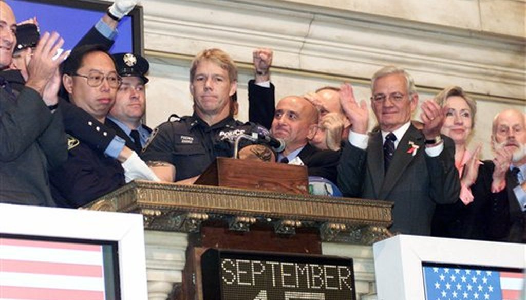 New York Stock Exchange Chairman Richard Grasso, center, is joined by politicians, members of New York's uniformed services and others on the bell podium as the the NYSE opening bell is rung, on Sept. 17, 2001 (AP/Richard Drew)