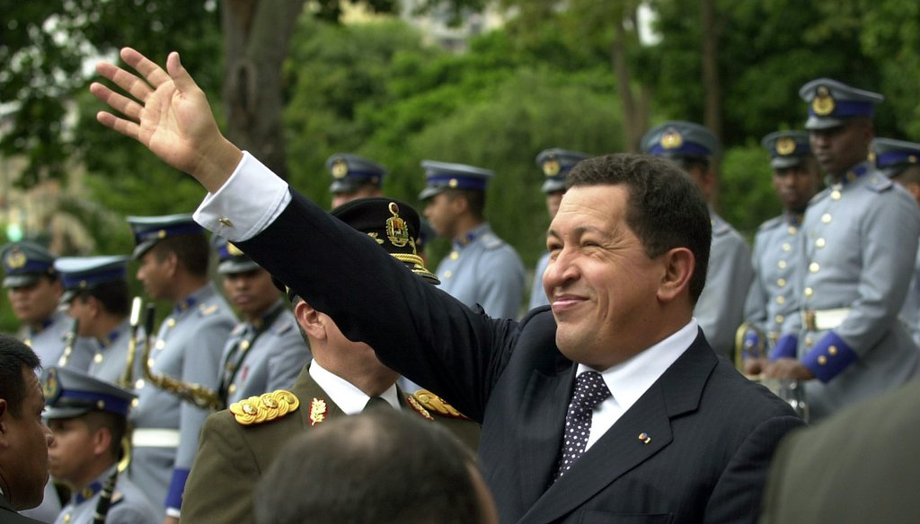 Venezuelan President Hugo Chavez greets his supporters in 2005. Chavez died in 2013. (AP)