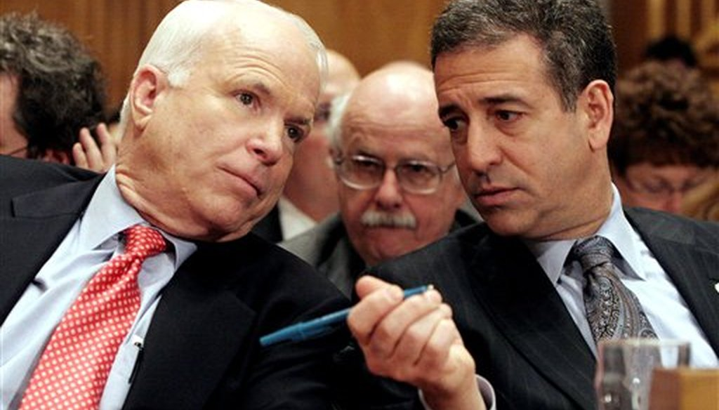 In this Jan. 25, 2006 file photo, Sen. John McCain, R-Ariz., left, chats with Sen. Russ Feingold, D-Wis. on Capitol Hill in Washington. (AP Photo/Lauren Victoria Burke, File)
