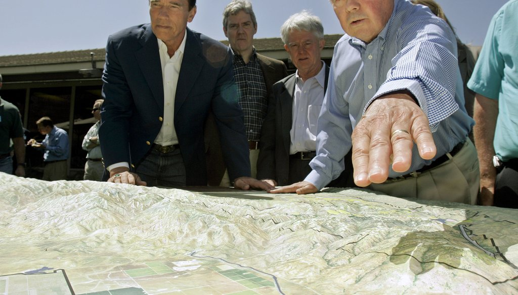 Bob Stine, right, CEO of the Tejon Ranch Co., examines a mockup of a vast nature preserve with then-California Gov. Arnold Schwarzenegger on May 8, 2008, in Lebec, Calif., north of Los Angeles. AP Photo/Ric Francis