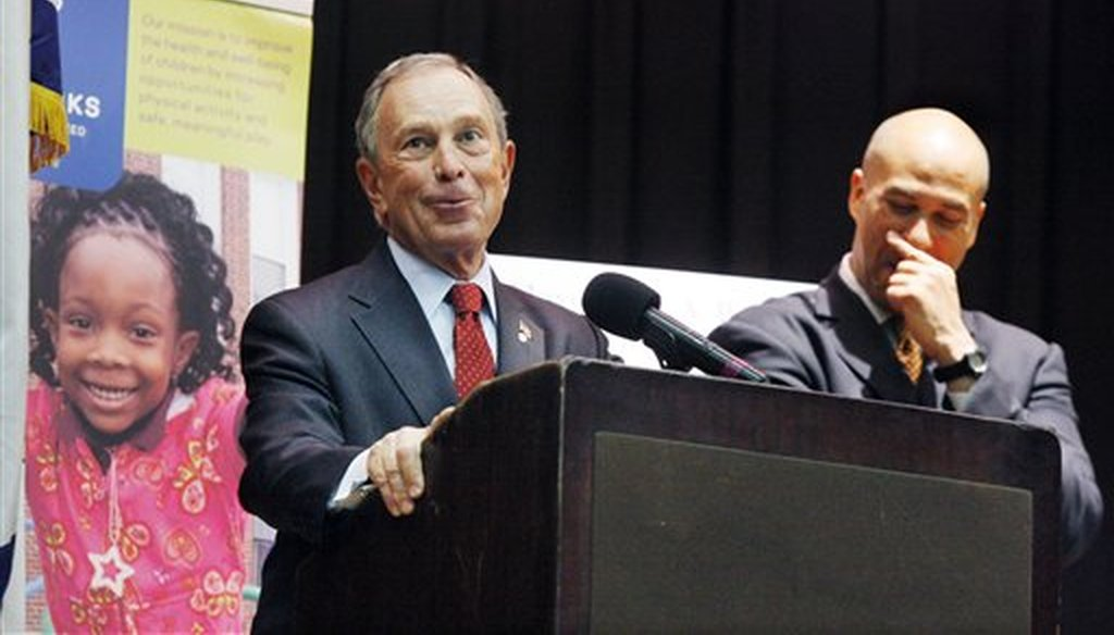 Then-Newark Mayor Cory Booker, right, laughs as then-New York City Mayor Michael Bloomberg makes a joke during an announcement on Sept. 29, 2010, in Newark, N.J. (AP/Evans)