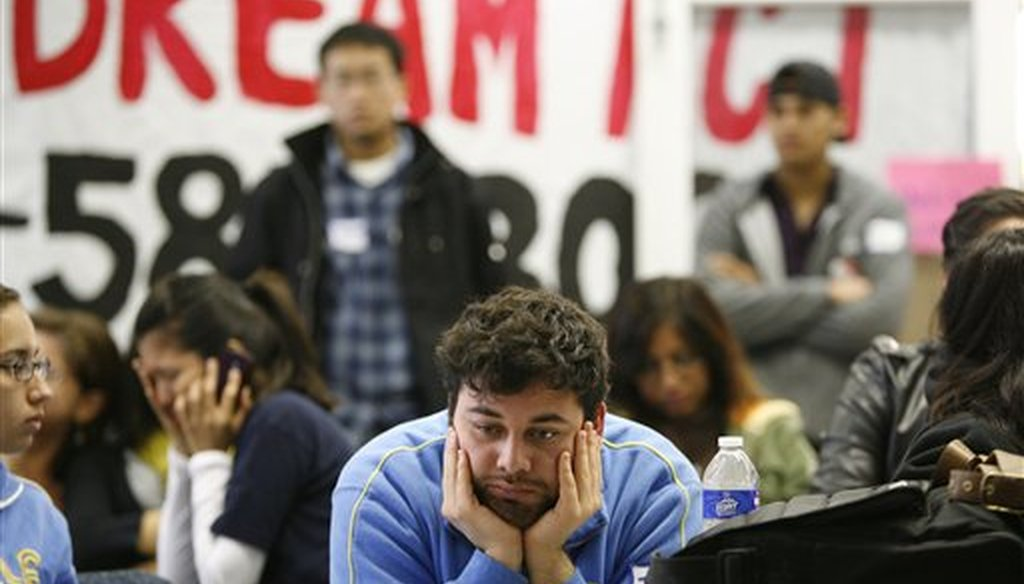In this 2010 file photo, UCLA student Jose Ortiz, 20, reacts as the Dream Act fails to move forward in the Senate during televised coverage of proceedings at the UCLA Downtown Labor Center in Los Angeles, Dec. 18, 2010. (AP/Jason Redmond)