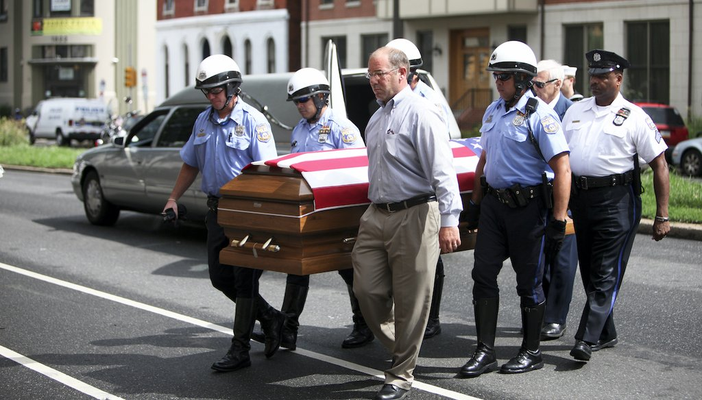 A police honor guard carries the remains of Petty Officer First Class Michael Strange, a U.S. Navy SEAL killed in the Aug. 6, 2011 helicopter crash in Afghanistan, to a Philadelphia funeral home on Aug. 15, 2011. (AP)