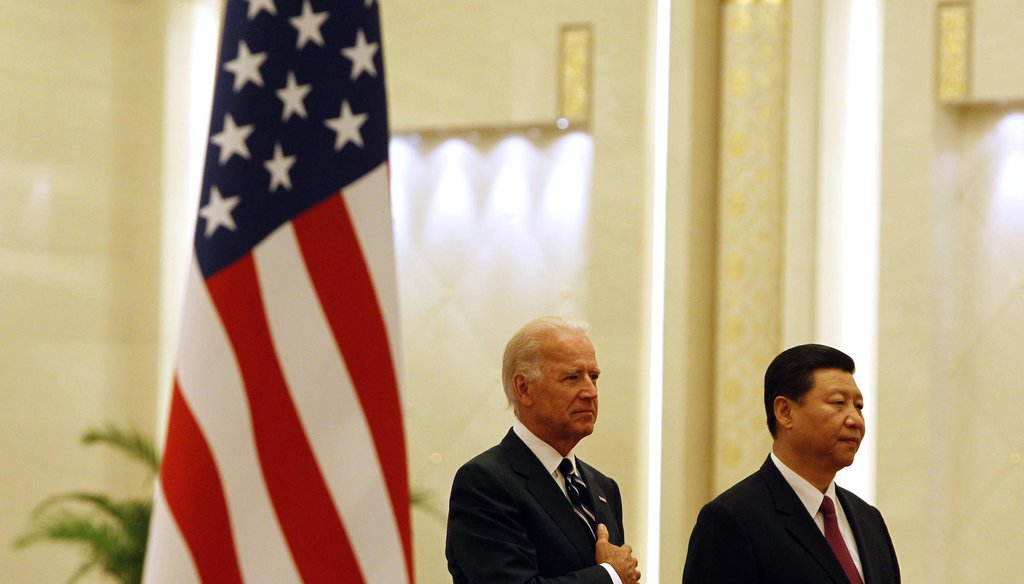 Joe Biden with Xi Jinping at the Great Hall of the People in Beijing. (AP)