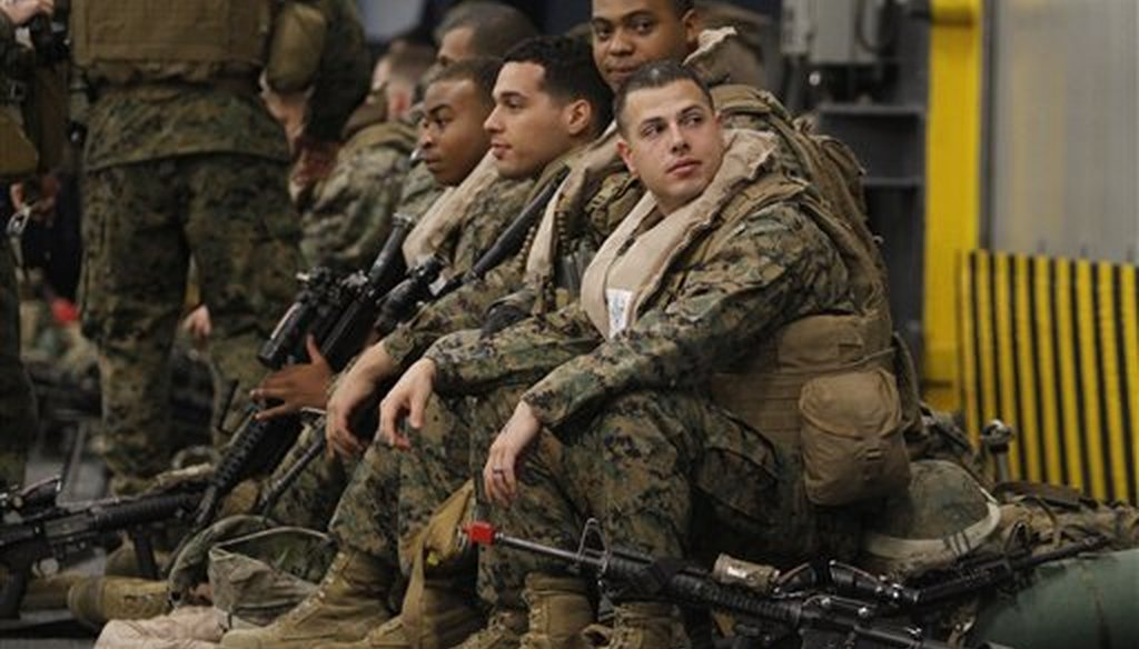 Marines based at Camp Lejeune wait to board a helicopter off the coast of Jacksonville, North Carolina, Monday, Feb. 6, 2012. (AP/Steve Helber)
