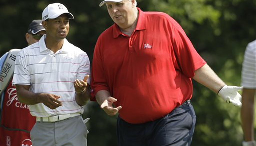 Greenbrier resort owner and future West Virginia Gov. Jim Justice talks to Tiger Woods at the resort in White Sulphur Springs, W. Va., on July 4, 2012. (AP)