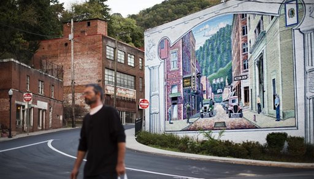 A mural depicting a more vibrant time in the town's history decorates a building in Welch, W.Va. (AP/David Goldman)