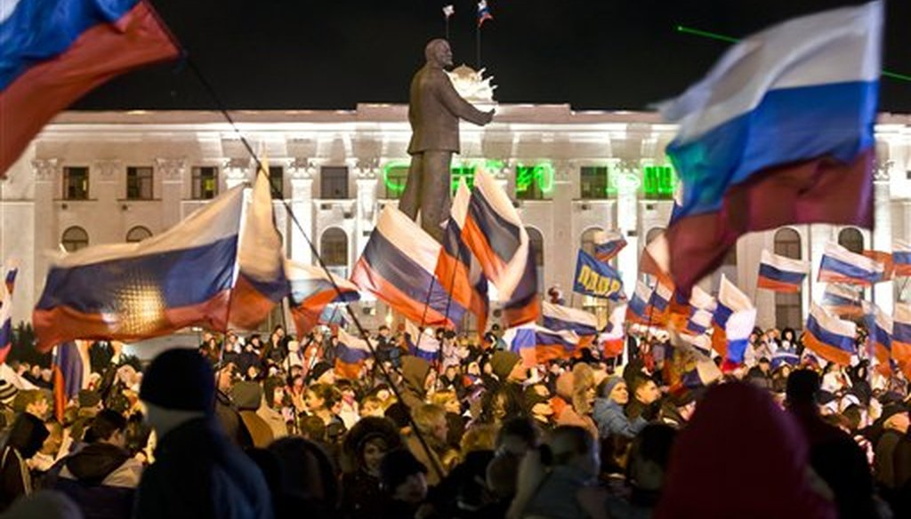 A pro-Russian crowd celebrates a referendum on seceding from Ukraine and seeking annexation by Russia, in Lenin Square in Simferopol, Crimea, on March 16, 2014. (AP/Vadim Ghirda)