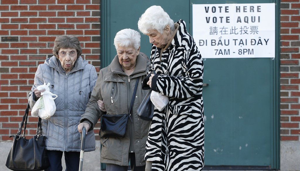 Three women leave a polling station for Massachusetts' primary election in the East Boston neighborhood of Boston, Tuesday, March 1, 2016. (AP)