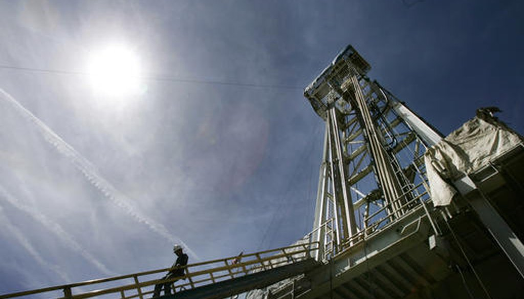 A worker steps down from a geothermal drilling platform at Newberry Crater near LaPine, Ore. (AP/Don Ryan)