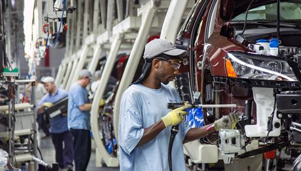 Employees at the Volkswagen plant in Chattanooga, Tenn., assemble Passat sedans on July 12, 2013. (AP/Erik Schelzig)