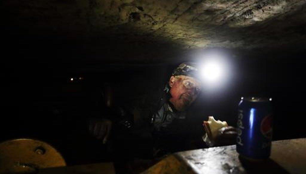 Coal miner Scott Tiller eats a sandwich during his lunch break in a mine less than 40-inches high in Welch, W.Va. (AP/David Goldman)
