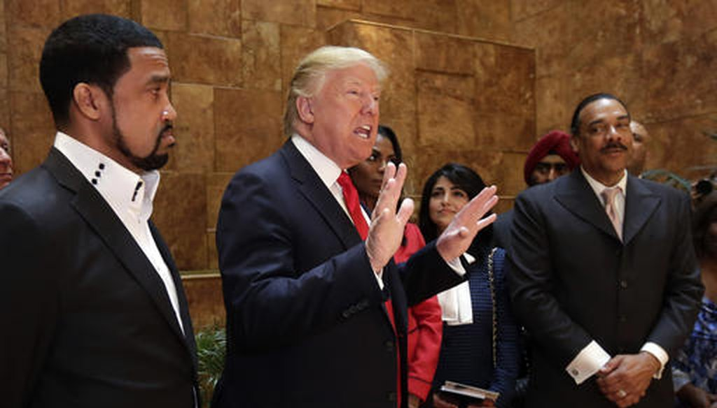 Pastor Darrell Scott, at left, listens as then-candidate Donald Trump speaks at Trump Tower on April 18, 2016.