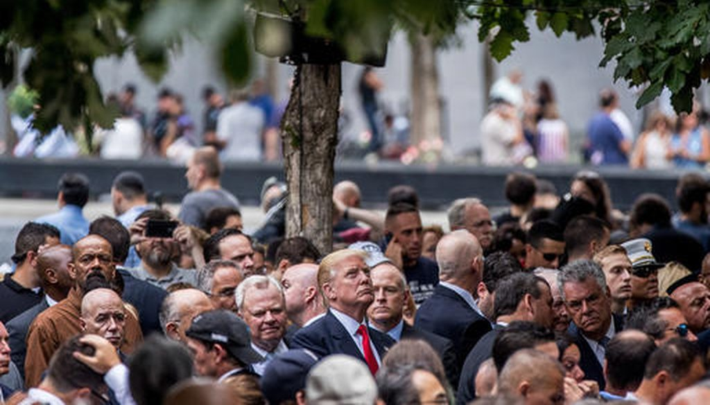 Then Republican presidential candidate Donald Trump, center, attends a ceremony at the Sept. 11 memorial, in New York, Sunday, Sept. 11, 2016 (AP).