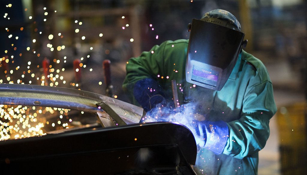 In this Sept. 18, 2015 photo, Sparks fly as a welder works on a frame for a school bus at Blue Bird Corporation's manufacturing facility in Fort Valley, Ga. Blue Bird Corporation. (AP Photo/David Goldman)