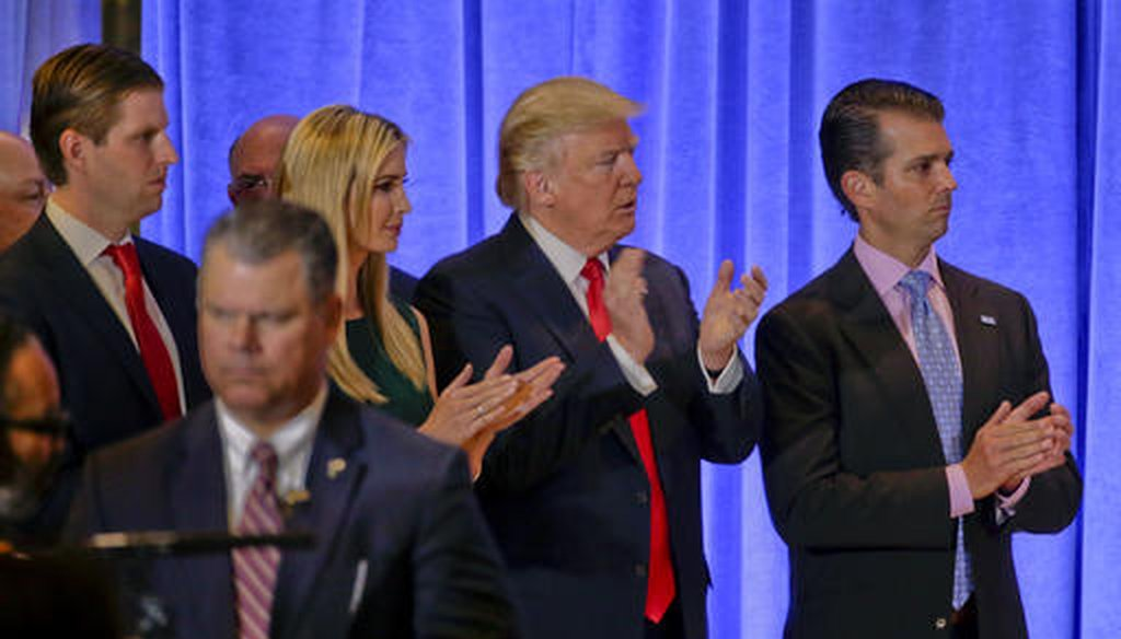 President-elect Donald Trump waits with family members Eric Trump, left, Ivanka Trump and Donald Trump Jr. before speaking at a news conference, Jan. 11, 2017, in New York. (AP/Seth Wenig)