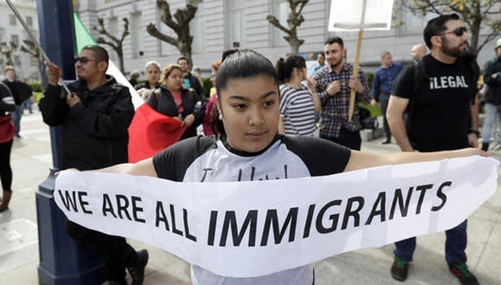 Delilah Gutierrez, 10, holds a sign during a protest against President Donald Trump's efforts to crack down on immigration on Feb. 16, 2017, in San Francisco. (AP/Marcio Jose Sanchez)