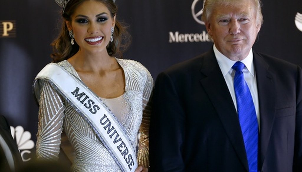 Miss Universe 2013 Gabriela Isler of Venezuela and Donald Trump pose for a photo after the 2013 Miss Universe pageant in Moscow on Nov. 10, 2013. (AP/Ivan Sekretarev)