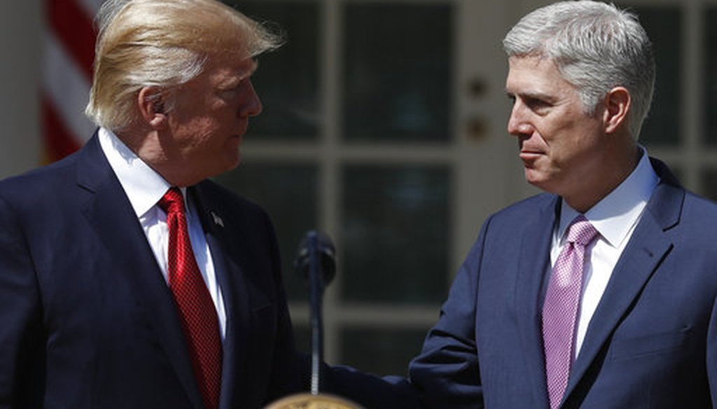 President Donald Trump greets his Supreme Court nominee, Neil Gorsuch, in the Rose Garden.