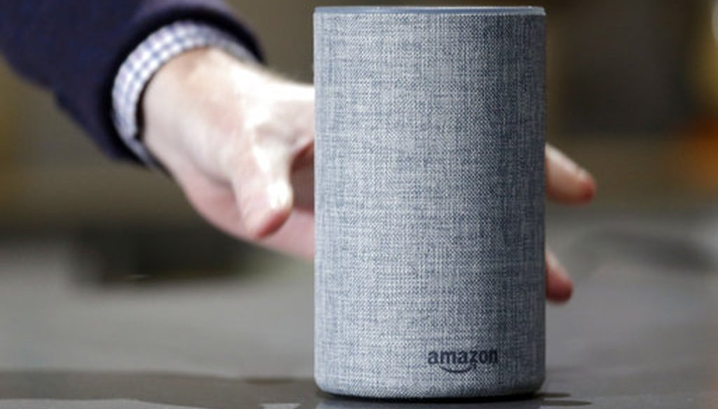An Amazon Echo is displayed during a program announcing several new Amazon products by the company Sept. 27, 2017, in Seattle. (AP Photo/Elaine Thompson)
