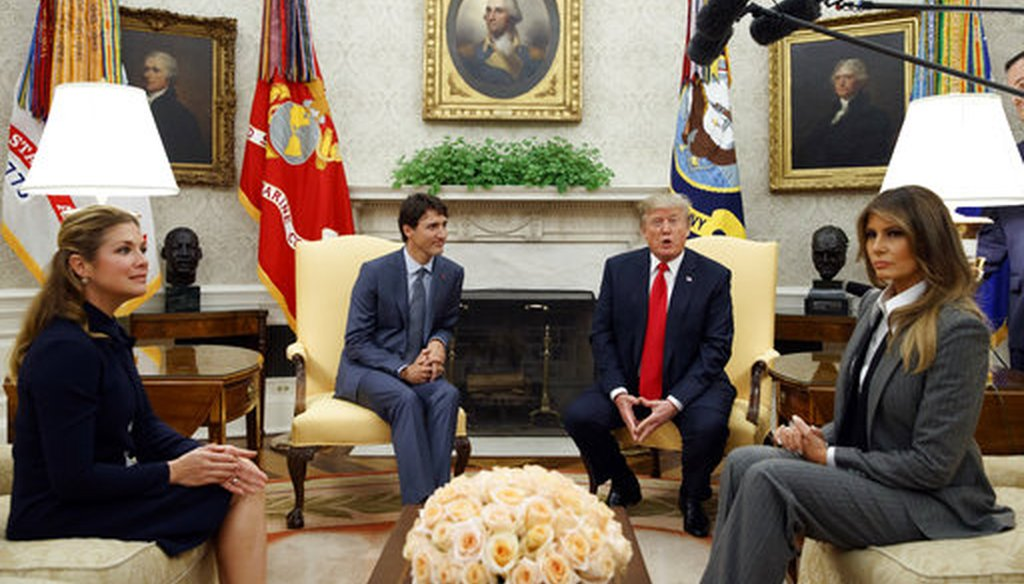 President Donald Trump and first lady Melania Trump welcome Canadian Prime Minister Justin Trudeau and his wife Sophie Gregoire Trudeau to the Oval Office on Oct. 11, 2017. (AP/Evan Vucci)