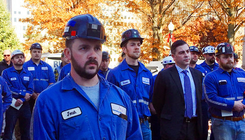 A group of coal miners listens to speakers at a pro-coal rally on Nov. 28, 2017, at the state Capitol in Charleston, W.Va. (AP/John Raby)