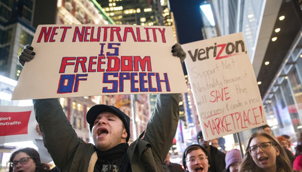 Demonstrators rally in support of net neutrality outside a Verizon store, Thursday, Dec. 7, 2017, in New York. (AP Photo/Mary Altaffer)