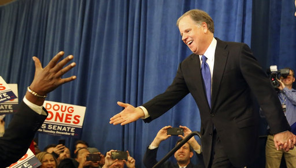Democratic candidate for U.S. Senate Doug Jones greets supporters before speaking during an election-night watch party Tuesday, Dec. 12, 2017, in Birmingham , Ala. Jones defeated Republican Roy Moore. (AP Photo/John Bazemore)