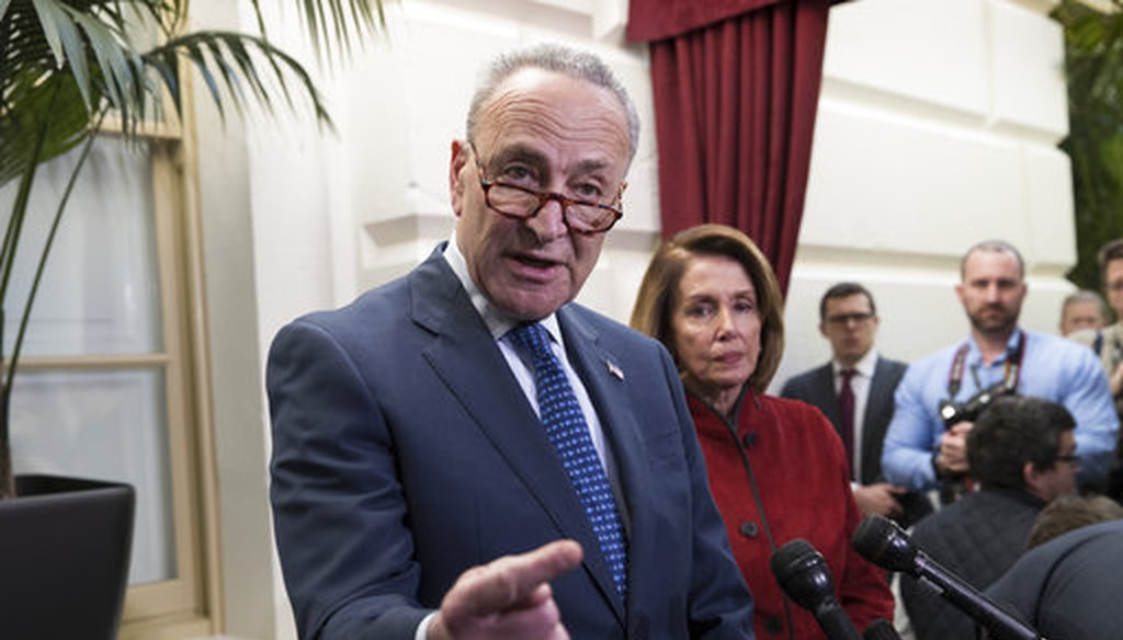 Senate Minority Leader Chuck Schumer, D-N.Y., speaks to reporters before House and Senate tax bill conferees met to work on the sweeping overhaul of the nation's tax laws on Dec. 13, 2017. (AP/J. Scott Applewhite)