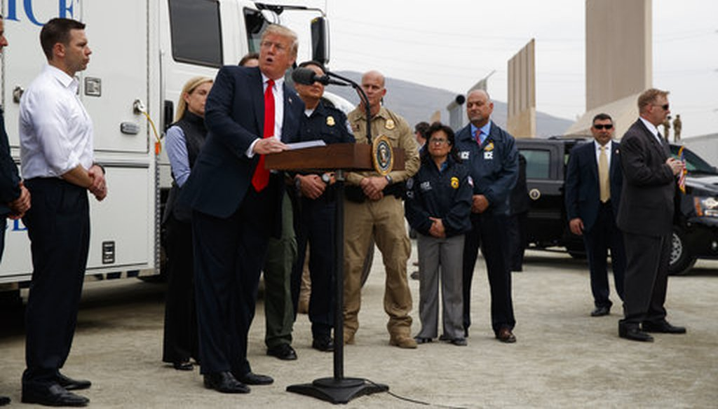 President Donald Trump talks with reporters after reviewing border wall prototypes, Tuesday, March 13, 2018, in San Diego. (AP Photo/Evan Vucci)