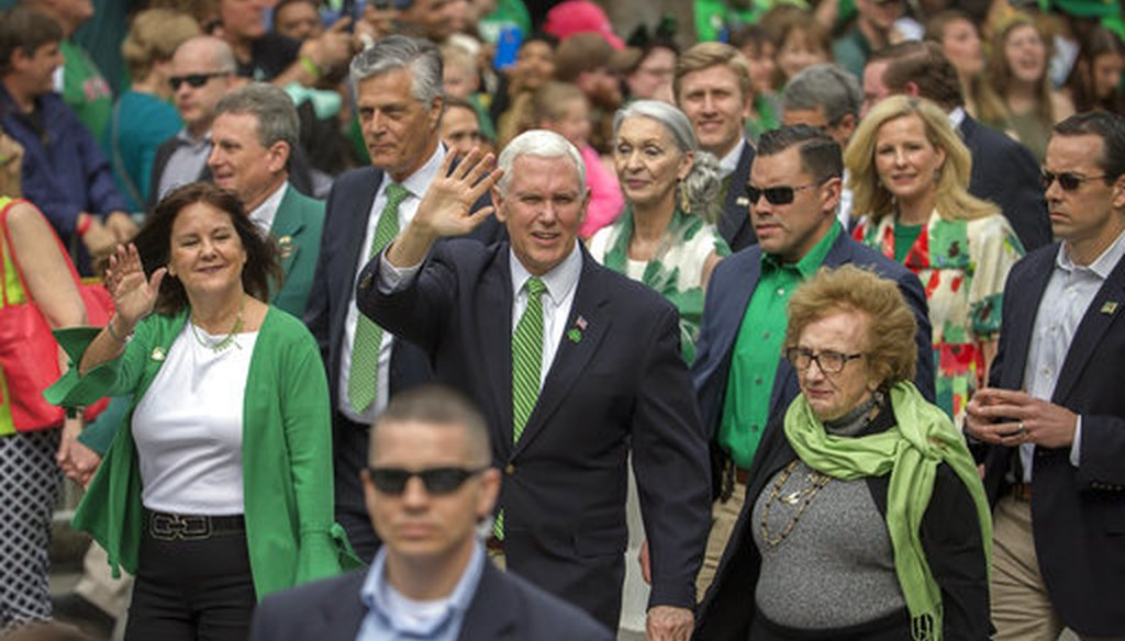 Vice President Mike Pence, center, his wife Karen Pence, left, and his mother Nancy Pence Fritch, right, march in the St. Patrick's Day parade Saturday, March 17, 2018, in Savannah, Ga. (AP Photo/Stephen B. Morton)