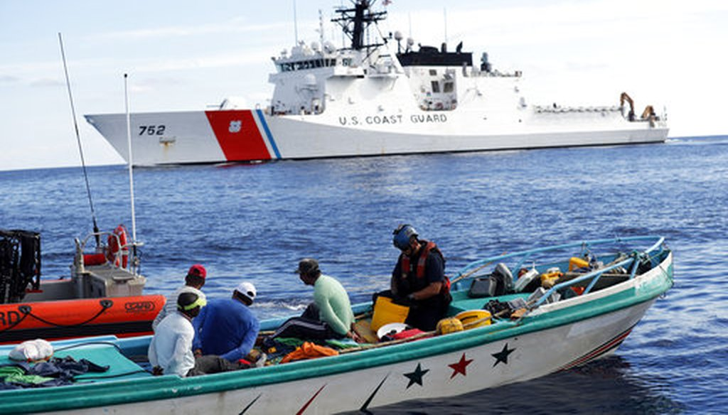 Feb. 23, 2017. U.S. Coast Guard law enforcement team boards a small fishing boat that was stopped carrying close to 700 kilos of pure cocaine, in the Pacific Ocean hundreds of miles south of the Guatemala-El Salvador border. (AP Photo/Dario Lopez-Mills)