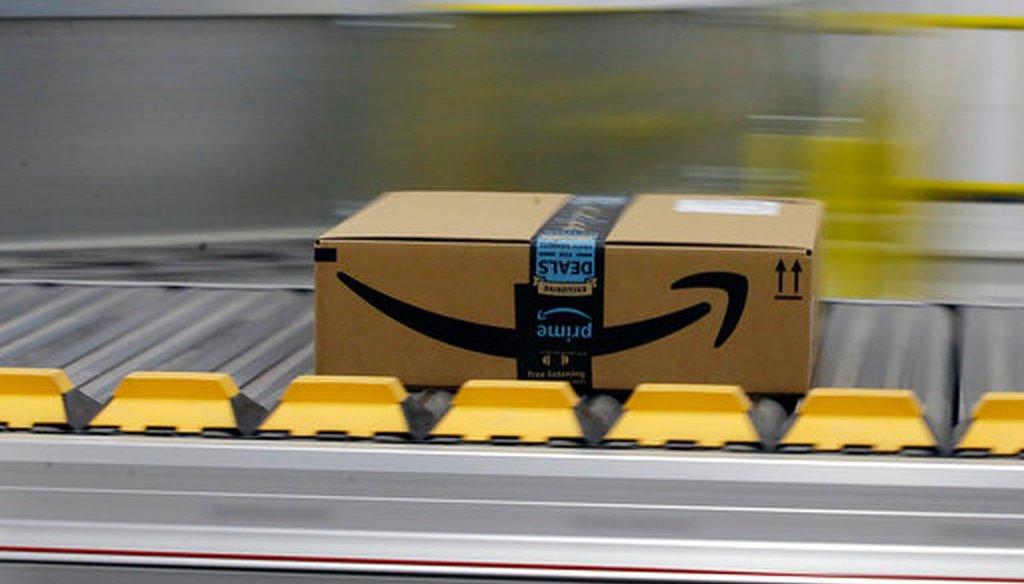 In this Feb. 9, 2018, file photo, a box for an Amazon prime customer moves through the new Amazon Fulfillment Center in Sacramento, Calif.  (AP/Rich Pedroncelli)