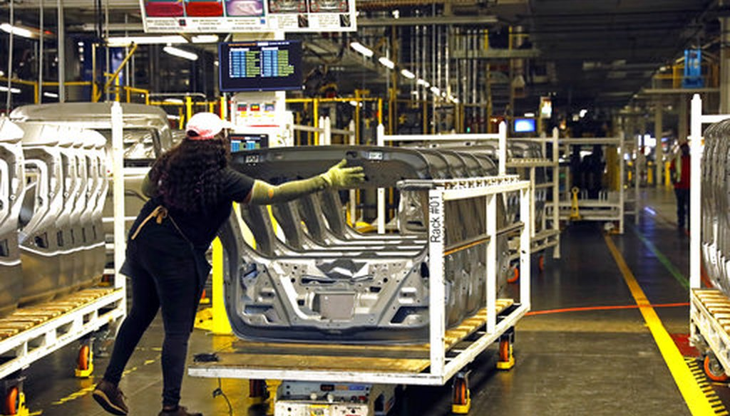 A technician supports an automated rack of unpainted panels to a work area on March 19, 2018, at the Nissan Canton Assembly Plant in Canton, Miss. (AP/Rogelio V. Solis)
